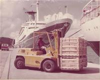 Vintage photo of vehicle with cargo for a ship